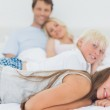 Siblings lying on the bed — Stock Photo