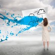 Creative businesswoman with blue paint splash  — Stock Photo