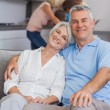 Elderly couple sitting on the couch — Stock Photo