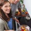 Couple cooking vegetables in the kitchen — Stock Photo
