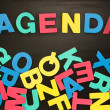 The word agenda written with colored letters — Stock Photo
