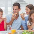 Stock Photo: Happy family eating pizzslices