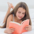 Happy young girl reading a book — Stock Photo