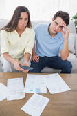 Concerned couple doing their accounts — Stock Photo