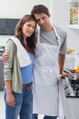 Couple embracing in kitchen — Stock Photo