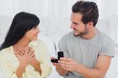 Man proposing to his surprised girlfriend — Stock Photo