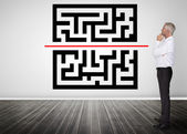 Thoughtful businessman looking at qr code — Stock Photo