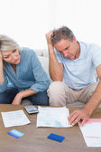 Anxious couple going over bills — Stock Photo