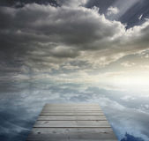 Wooden bridge leading to horizon — Stock Photo