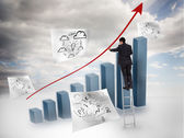 Businessman drawing a red arrow over a chart — Stock Photo
