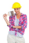 Beautiful handy woman holding a brush — Stok fotoğraf