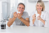 Happy couple having coffee in the morning — Stock Photo