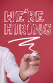 Businessman underlining we're hiring — Stock Photo