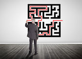 Businessman drawing line through quick response code — Stock Photo