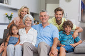 Multi-generation family posing in the living room — Stock Photo