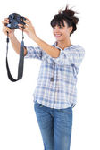 Brunette taking picture with her camera — Stock Photo