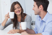 Beautiful couple drinking a cup of coffee — Stock Photo