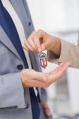Woman giving key — Stock Photo