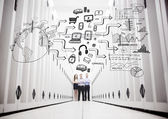 Colleagues in a data center standing in front of a drawing — Stock Photo
