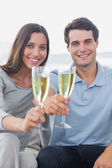 Portrait of a couple toasting their flutes of champagne — Stock Photo