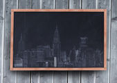 Drawing of a city on a blackboard — Stock Photo