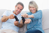 Couple playing video games on the sofa — Stock Photo