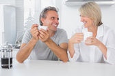 Cheerful couple having coffee in the morning — Stock Photo