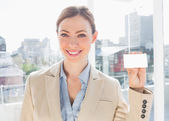 Smiling businesswoman showing blank business card — Stock Photo
