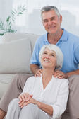 Man giving shoulder massage to wife — Stock Photo