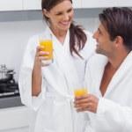 Couple drinking orange juice — Stock Photo