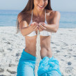 Woman in sarong playing with sand — Stock Photo