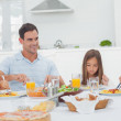 Family eating pasta with sauce — Stock Photo #28051087