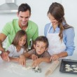 Siblings home baking together in the kitchen — Stock Photo