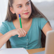 Thinking girl doing her homework — Stock Photo
