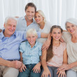 Stock Photo: Extended family smiling at camera