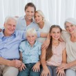 Extended family smiling at camera — Stock Photo