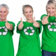Three women wearing green recycling tshirts giving thumbs up — Stock Photo