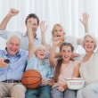 Extended family watching the tv — Stock Photo #28052241