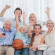 Extended family watching the tv — Stock Photo