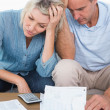 Worried couple going over bills — Stock Photo