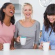 Stock Photo: Happy friends having coffee together