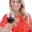 Woman holding red wine glass — Stock Photo