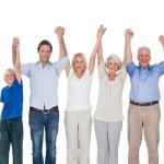 Smiling family raising their arms — Stock Photo