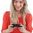 Foto de Stock  : Womholding video games joystick