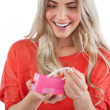 Blonde woman discovering necklace in a gift box — Stock Photo
