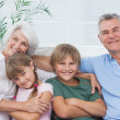 Portrait of grandparents with their grandchildren — Stock Photo #28053827
