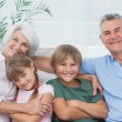 Stock Photo: Portrait of grandparents with their grandchildren
