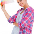 Young woman holding color charts and smiling at camera — Stock Photo #28054457