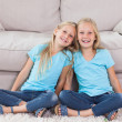 Stock Photo: Twins sitting on a carpet