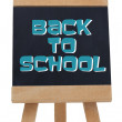Back to school written in blue on chalkboard  — Stock Photo